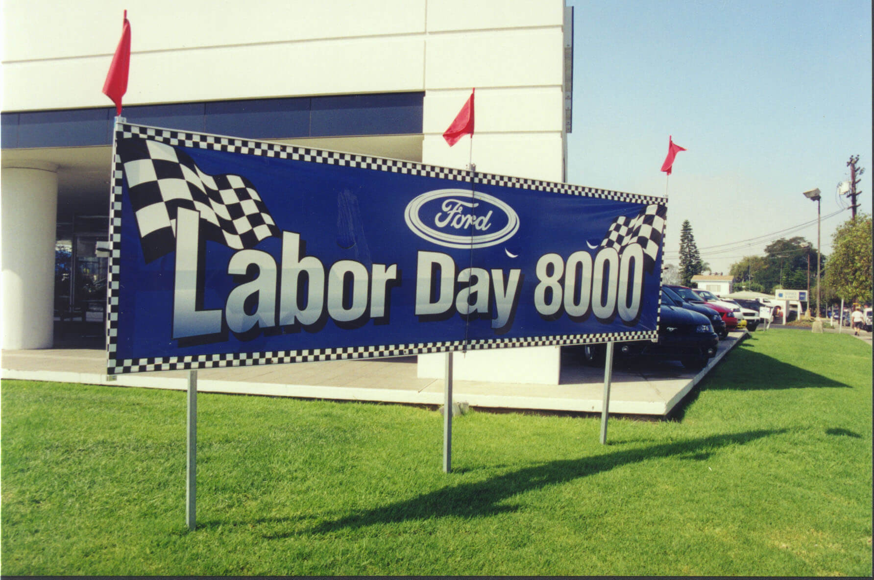A lawn display for outdoor marketing in a car lot from Voxpop Marketing Systems