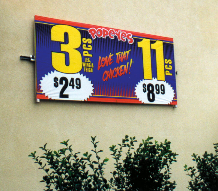 Wall mounted banner frames and signboards displaying deals