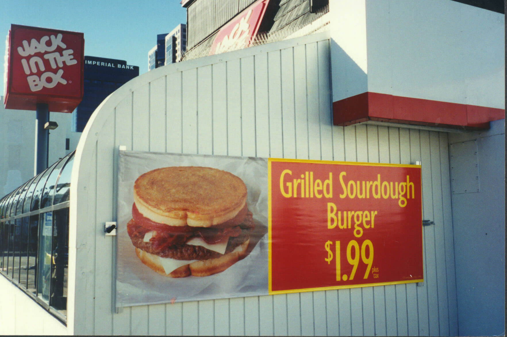 An outside marketing display of a burger from Voxpop Marketing Systems