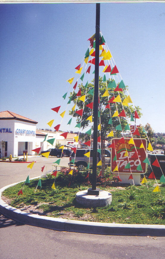 Blade flags outdoor displays in front of Del Taco