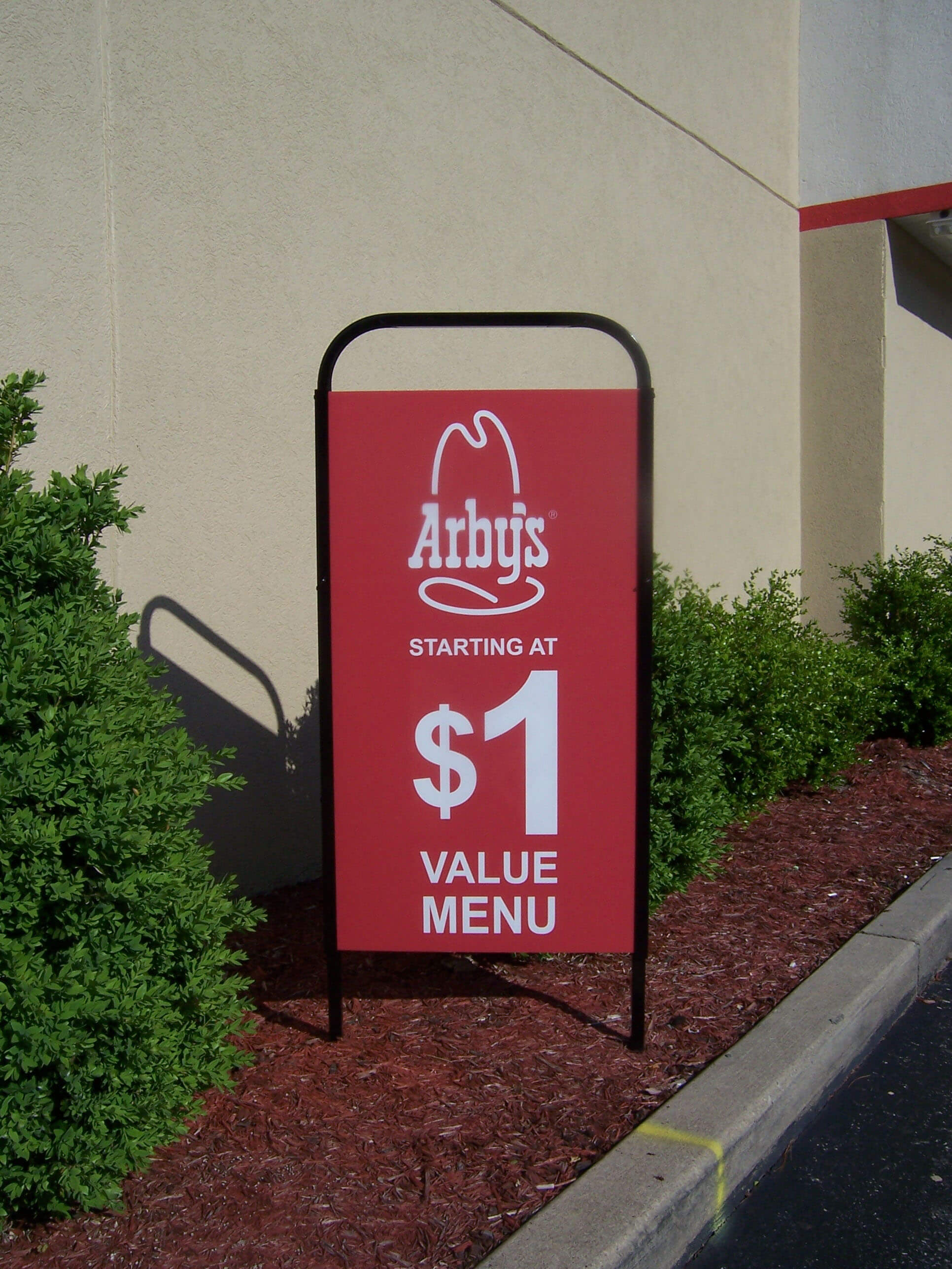 Exterior merchandising with drive thru displays at Arbys